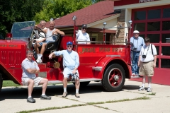George and other fire apparatus enthusiasts documenting area apparatus.