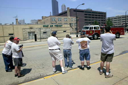 photographers taking pictures of a fire truck