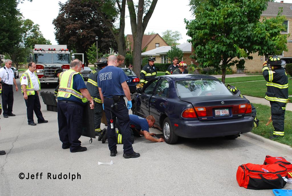 Skokie Fire Department man stuck under a car 8-30-11