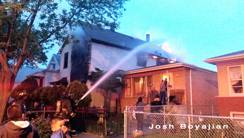 Chicago firefighters fight residential fire