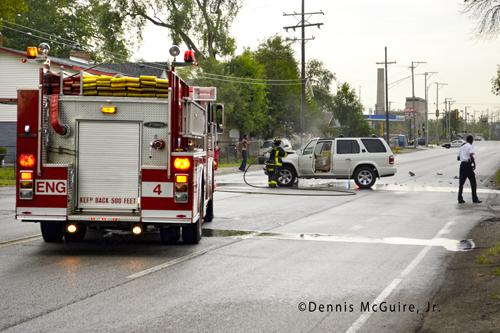 car fire in Harvey Fire Department firefighter