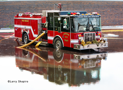 Luverne fire engine standing in water at lumberyard fire