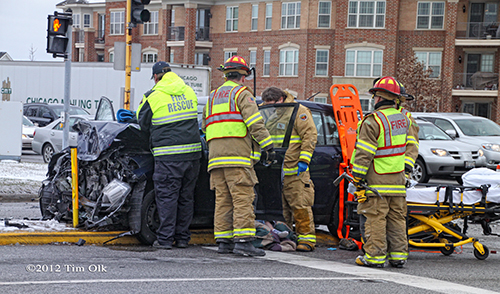firefighters helping crash victim