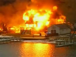 Houses burn in Webster, NY after four firefighters were shot, two of which died.