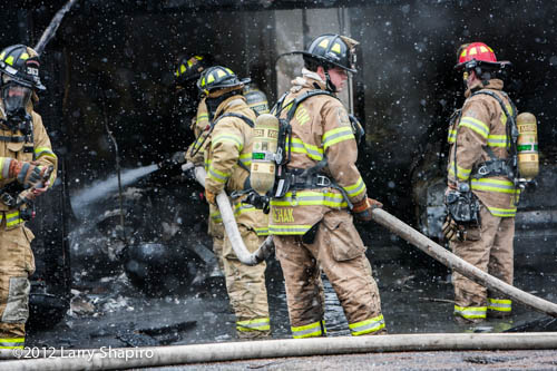 firefighters with a hose line