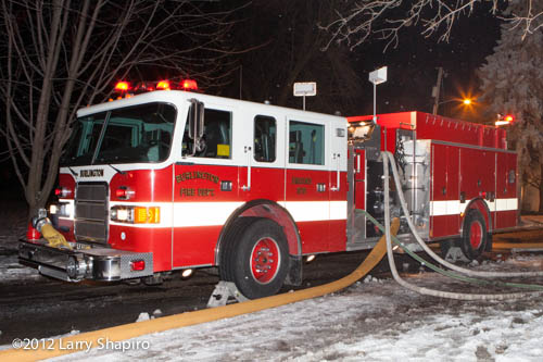 Pierce top-mount engine pumping at winter fire