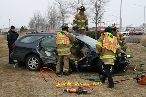 firefighters extricate drive from car