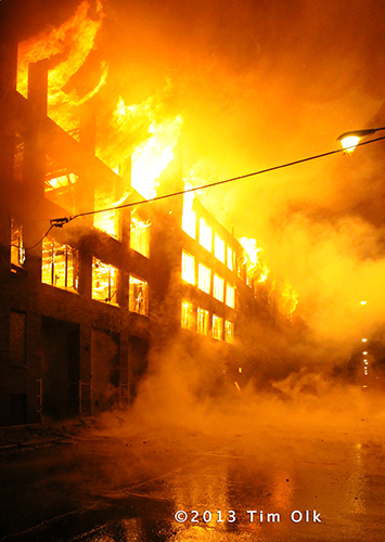 massive fire in warehouse at night
