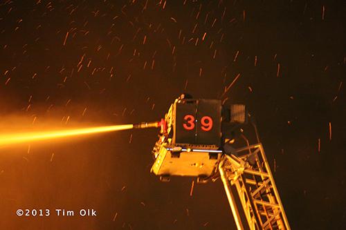 fire department tower ladder at fire sene