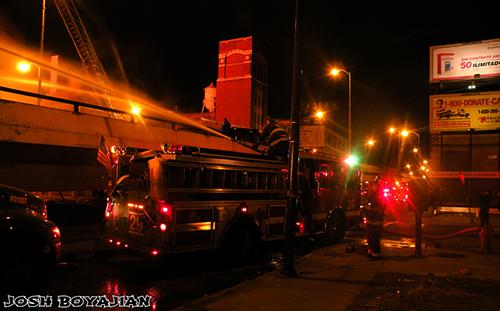 firefighters battle huge warehouse fire
