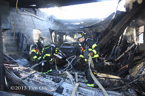auto repair shop fire in Franklin Park on Mannheim Road firefighters doing overhaul