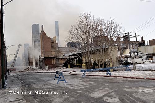 ruins of a massive warehouse fire