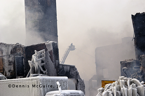 ice covered ruins of building fire