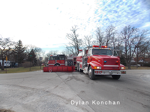 fire tankers bring water to fire scene