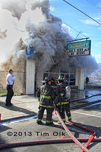 firefighters working at building fire