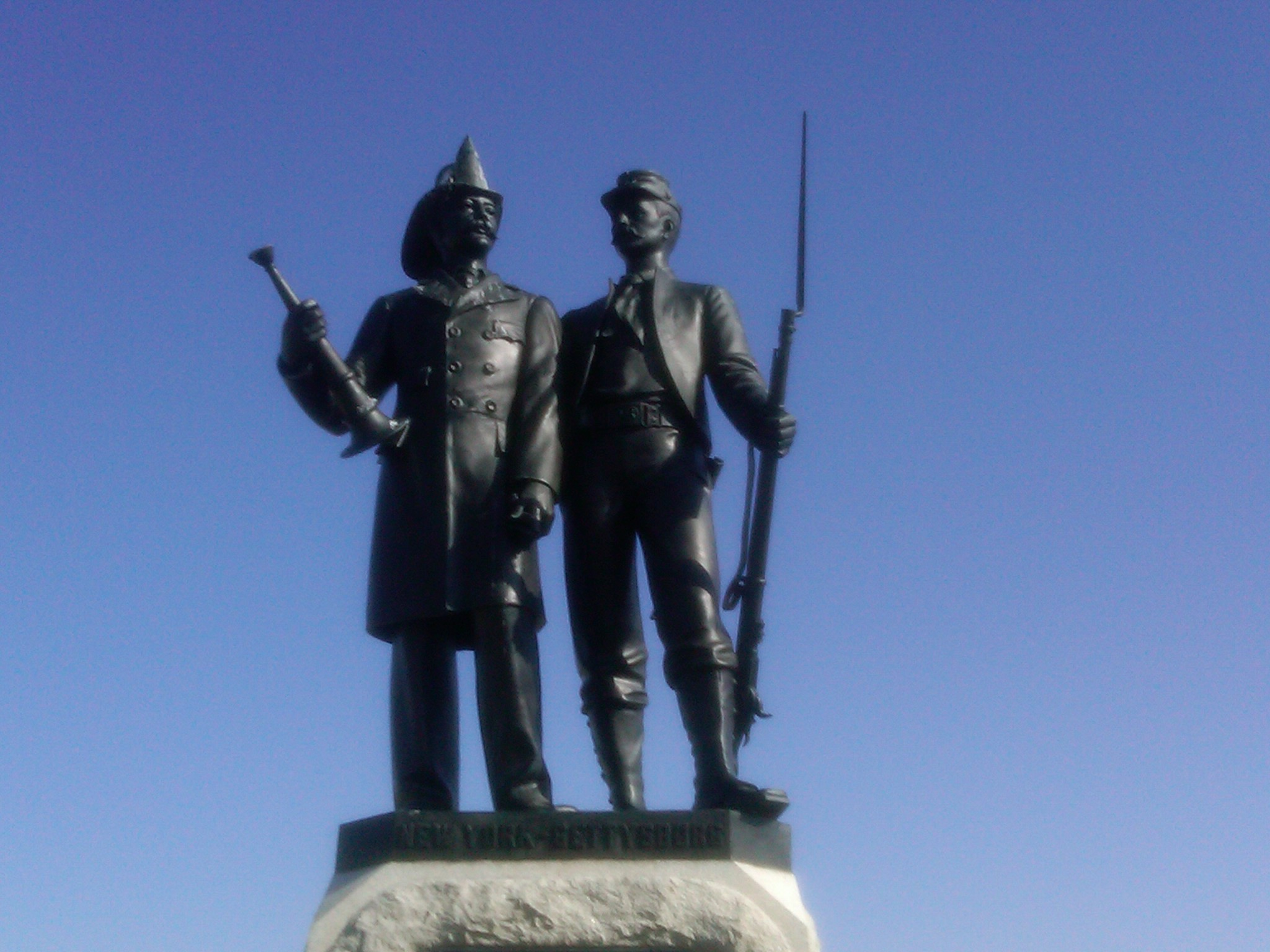 statue of a fireman and a soldier erected by the NYC volunteer firemen in tribute to those brothers who fought in the battle and gave their life.
