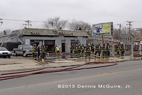 firefighters working at fire scene