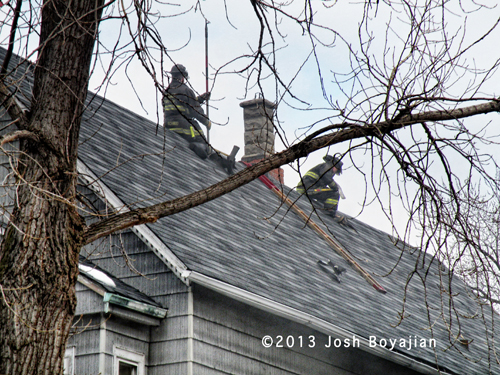 Chicago firefighters working on a roof