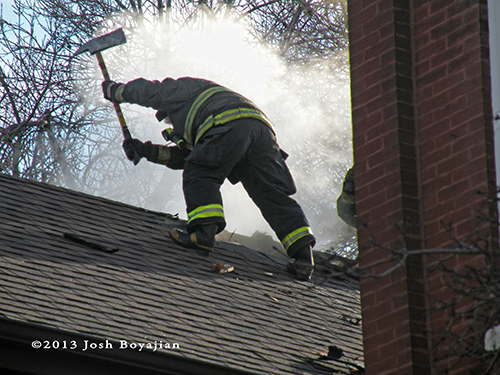 firefighter with axe on the roof