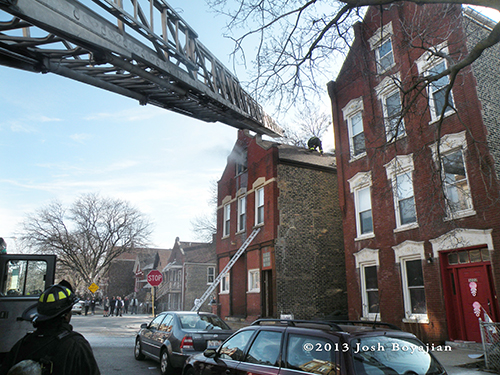 aerial ladder truck to roof of apartment building