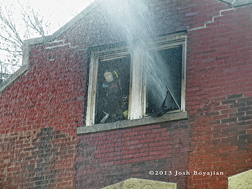 fire hose spray through window