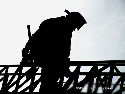 firefighter silhouette on ladder