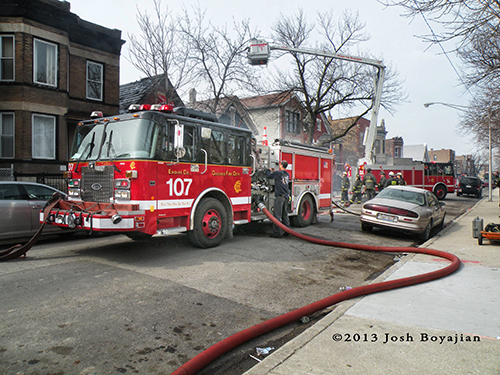 Chicago Engine 107 working at fire scene on Fairfield