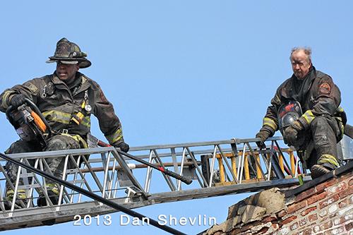 two firemen on ladder