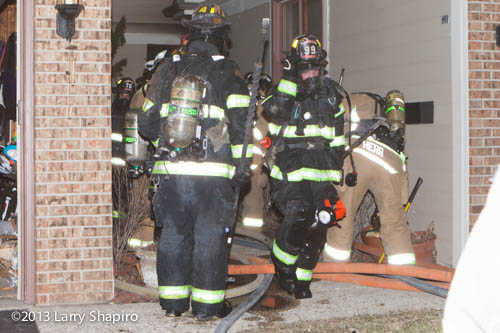 firefighters exiting burning house