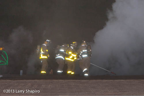 firefighters venting a roof