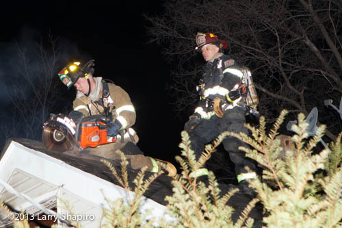 fireman cutting roof at fire