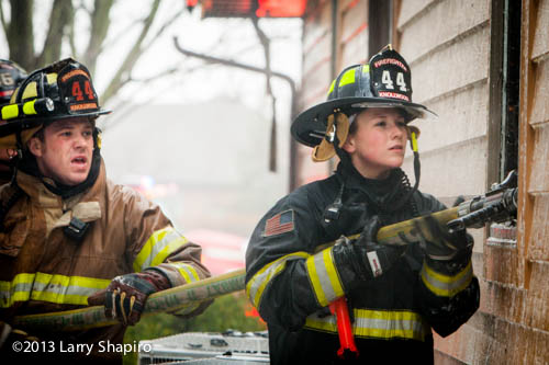 female firefighter on a line