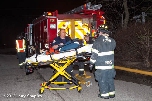 Schaumburg Ambulance 54 arrived after the 3rd alarm and medics seen here are about to tend to an injured firefighter. Larry Shapiro photo