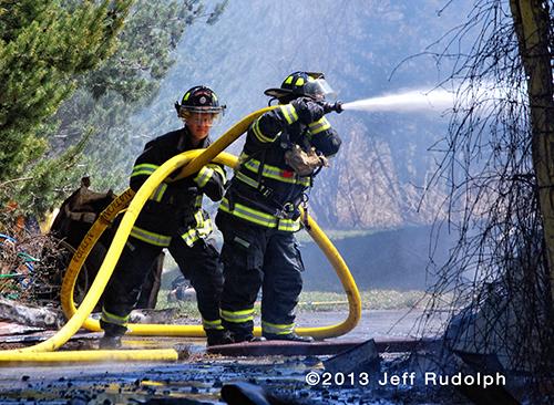 firemen use 2 1/2 inch hose line