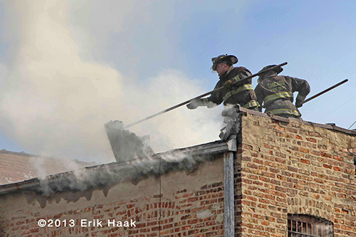 Chicago firefighters on the roof with smoke