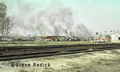 Railroad ties on fire in the 1980s.