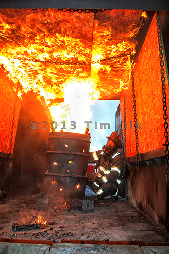 firemen training with live fire