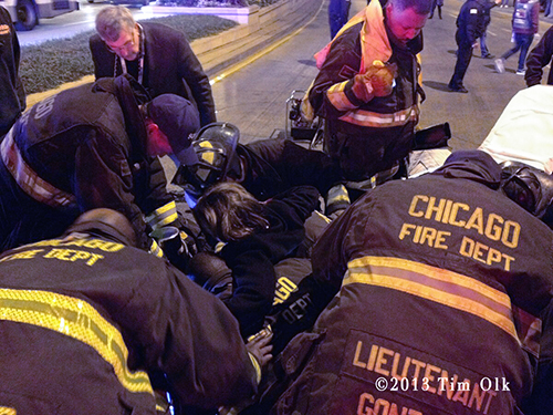 Chicago Fire Department frees woman from bridge