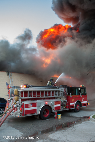 Massive 4-alarm fire on Chicago's north side destroys strip center and 5 stores.