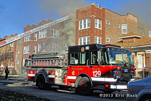 Chicago firefighters battle smokey building fire