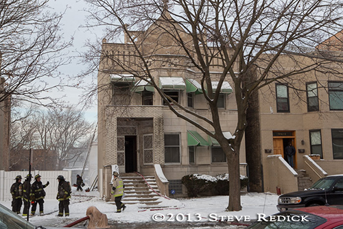 Chicago firefighters at winter fire scene