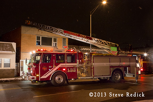 Leyden Township FPD quint working at night fire scene