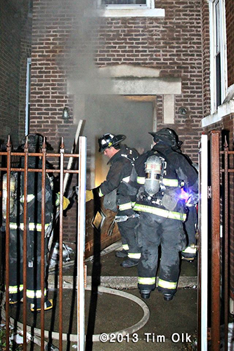 Chicago firefighters at night fire scene involving an apartment building