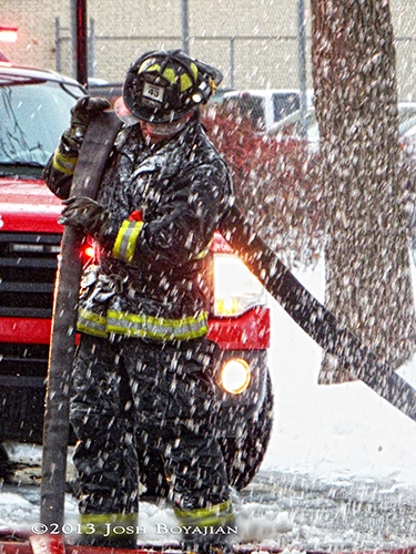 Chicago fireman at winter fire scene