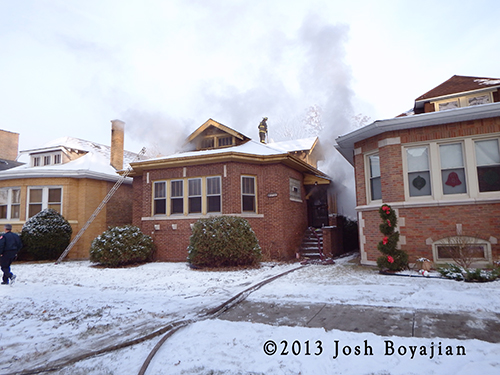 Chicago firemen battle winter fire in a Chicago bungalow