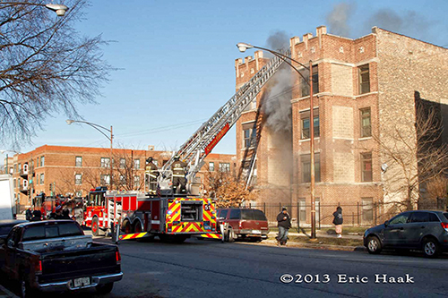 Chicago firemen battle an apartment is freezing temperatures.