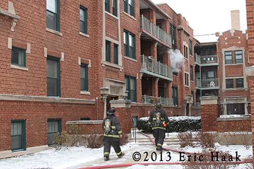 Chicago firemen at winter fire scene at courtyard building