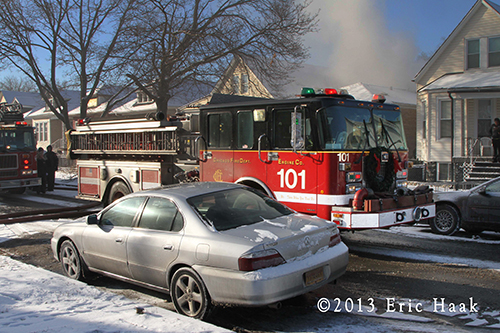Chicago firemen battle smokey house fire at year's end