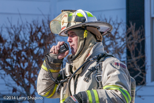 fire chief with radio at fire scene