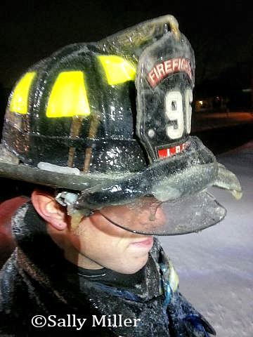 fireman with ice encrusted helmet